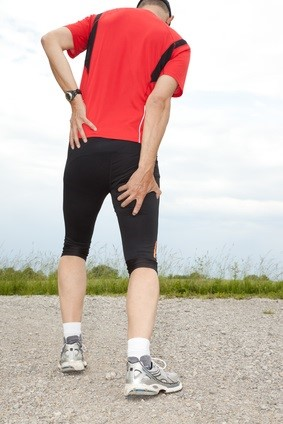 runner suffering from pain in hamstring or hamstring injury