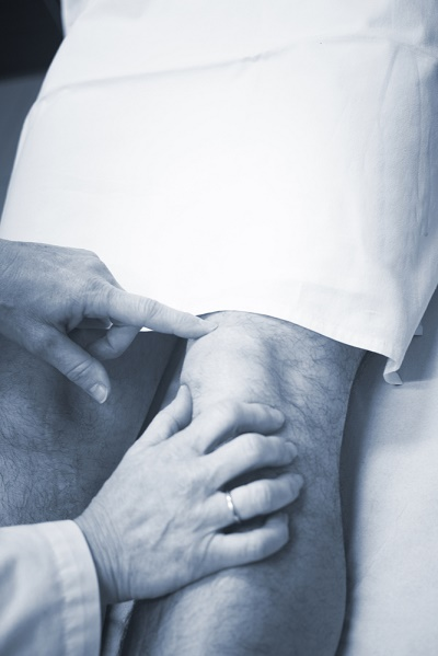 Orthopedic surgeon preparing for knee replacement
