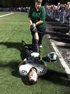 athletic trainer kelly pike in action