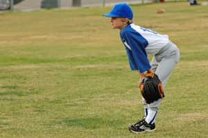 A young baseball player, suffering from Little Leaguer's Elbow